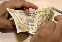 Indian rupee hits 6-month low at 55.41 on firm dollar