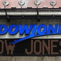 Dow rises to intraday record; Japan widens stimulus
