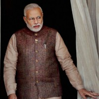 Modi picks up pace on economic reform, opposition remains