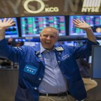 Wall Street gains for third day, led by energy shares