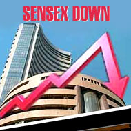 Sensex falls for second day after record; Tata Motors drag