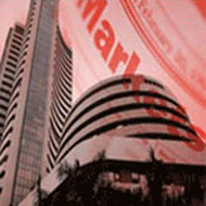 Sensex snaps 8-day gains, falls 145 pts; Tata Motors tanks